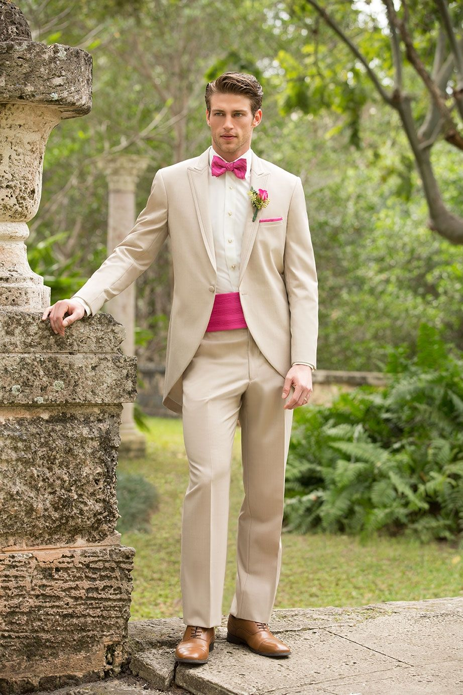 This tan coloured tux by Allure men features an open cut ...