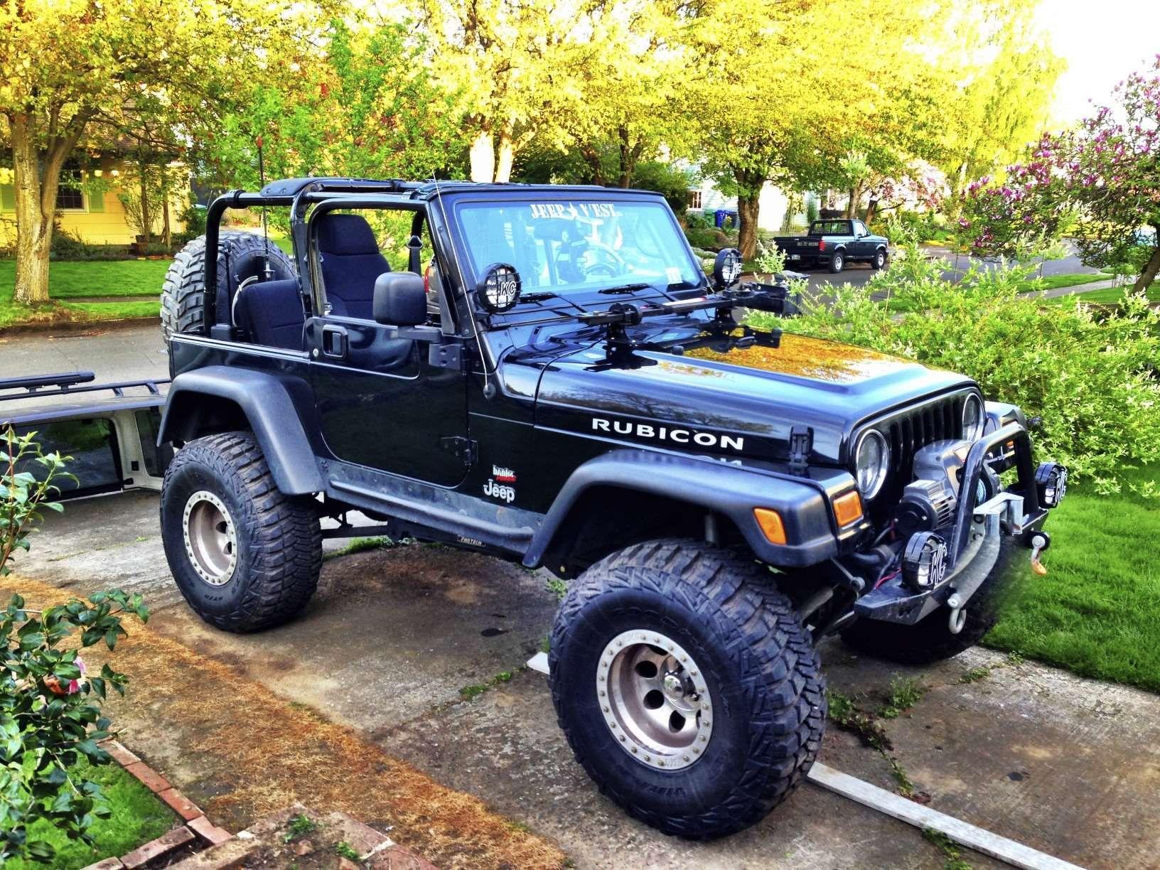 make jeep model wrangler year 2004 exterior color black interior color black doors two. Black Bedroom Furniture Sets. Home Design Ideas