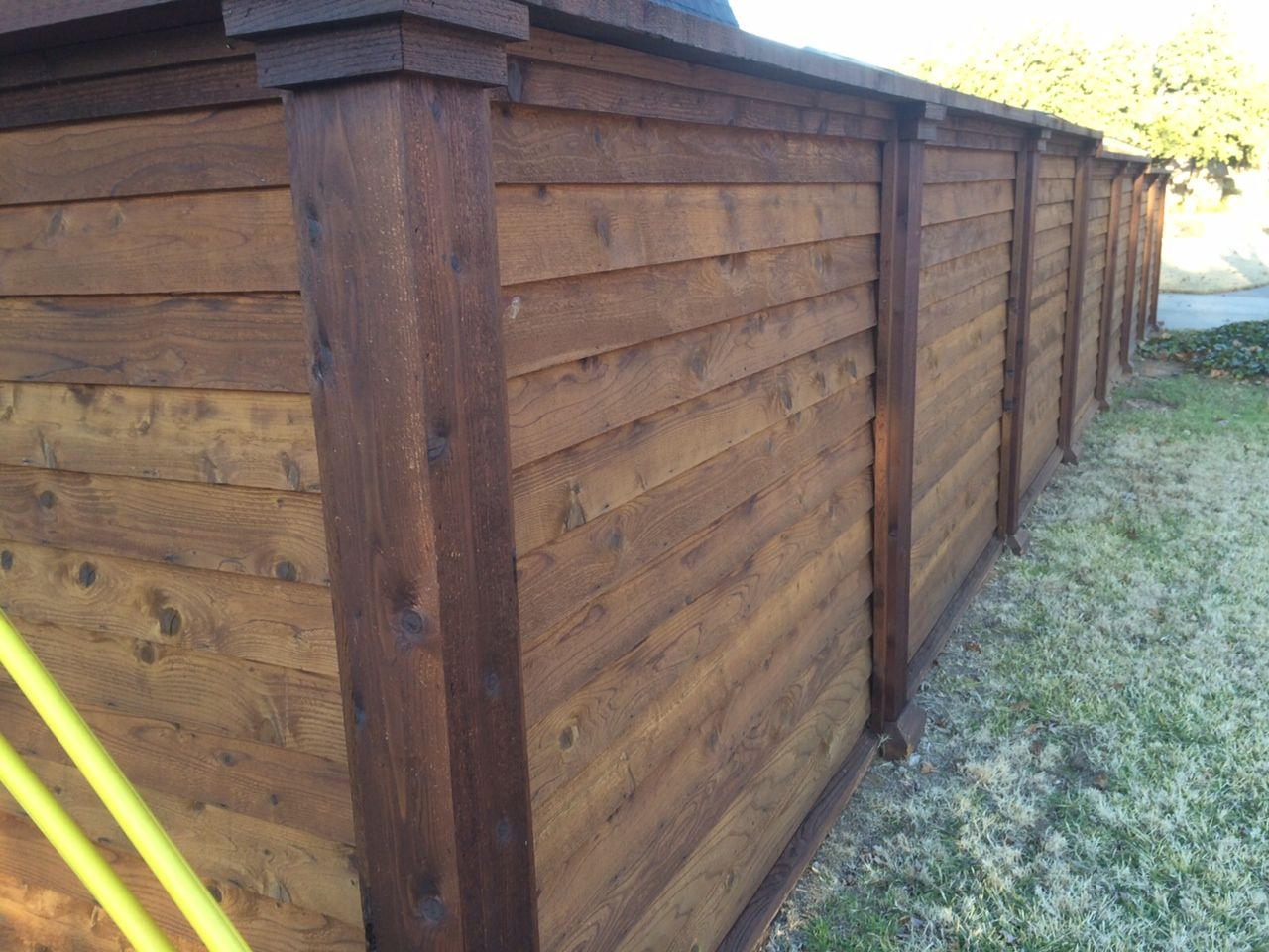 Design installation of outdoor projects patios structures horizontal cedar fence w boards lapped baanklon Images