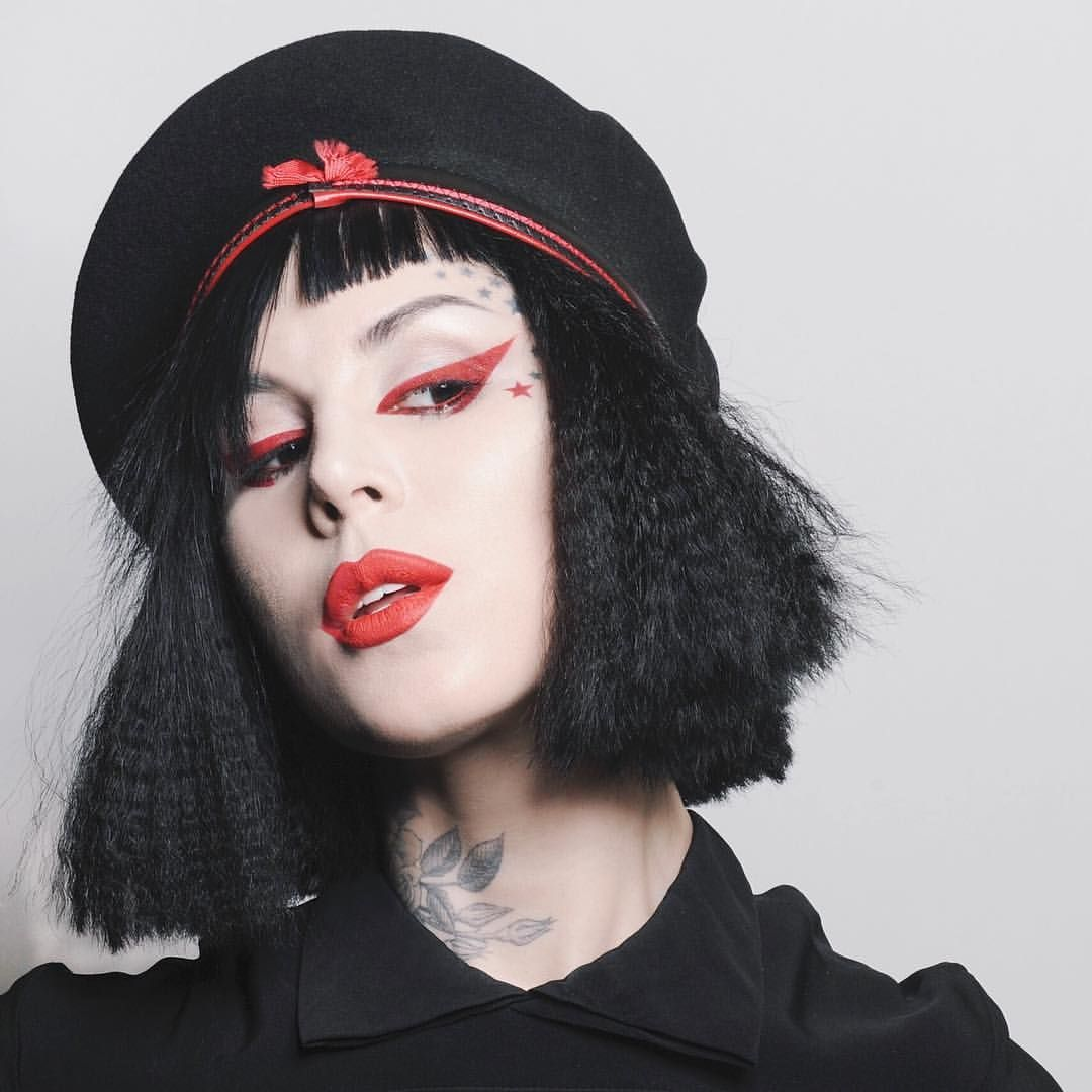 "Kat Von D on Instagram: ""Well, hello! ❤️ For this look I used @sugarpill red eyeshadow for eyeliner in ""Love+"" red + @katvondbeauty Studded Kiss Lipstick in ""Underage Red."" *and yes, I cut my hair with a dull pair of school library scissors. And yes, I crimped the fuck out of it, too."""