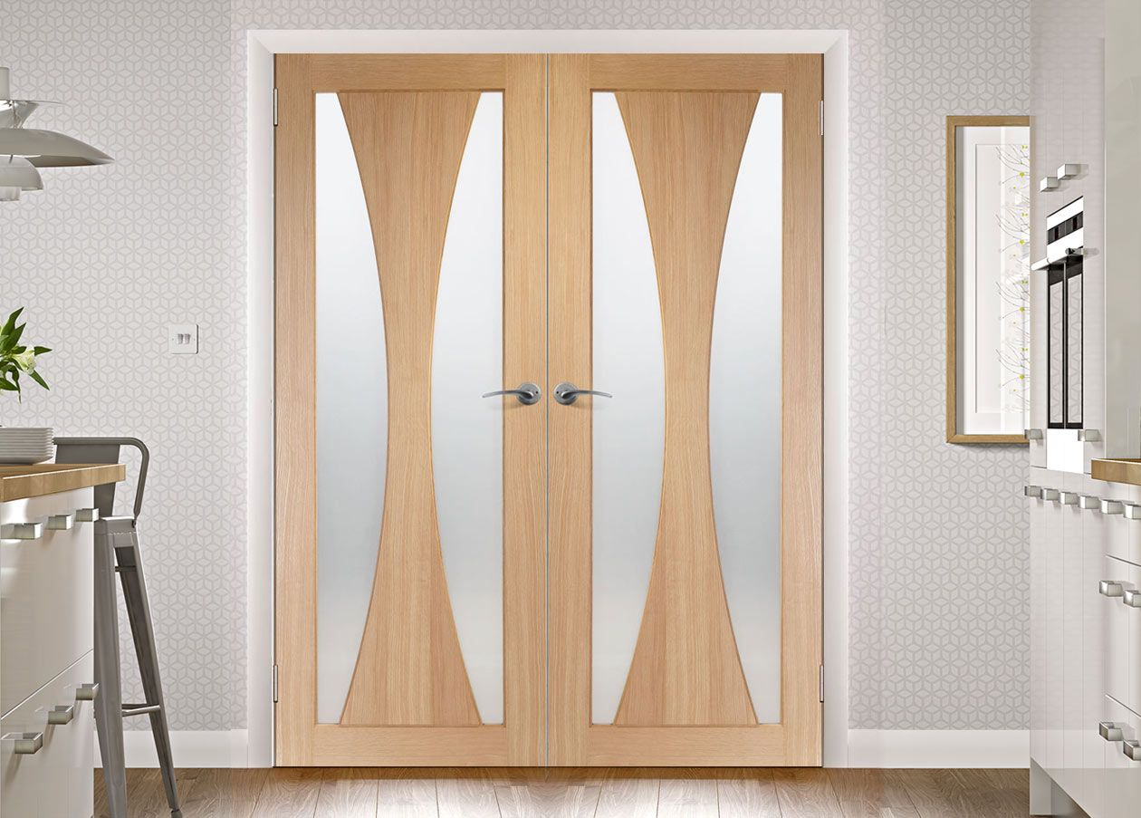 The Verona oak french door pair with obscure safety glass is a new and stunning style which will grace any home, free delivery will help get it there even quicker. #obscuresaafetyglassdoors #designerfrenchdoors internalfrenchdesignerdoors