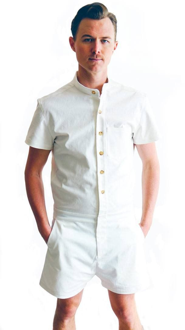 26d3a2e72f4 Product shot of model wearing White cotton male romper by RompHim (front  view)