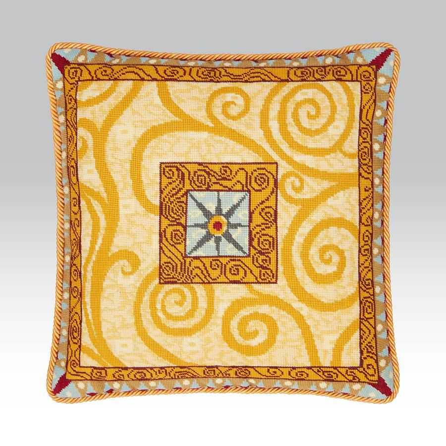 A large decorative cushion with a feel of egyptian design and gustav