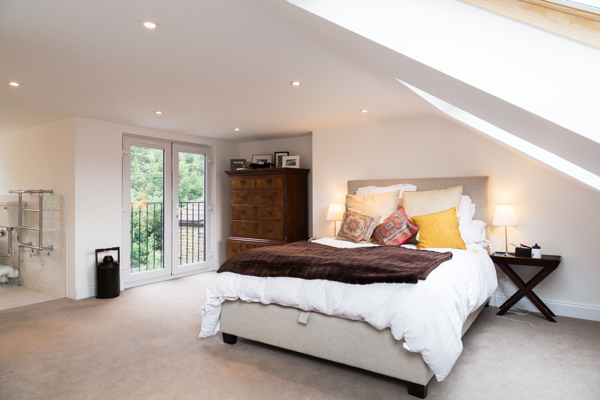 Loft room bedroom ideas  Bedroom with Juliet balcony part of a loft conversion in South East