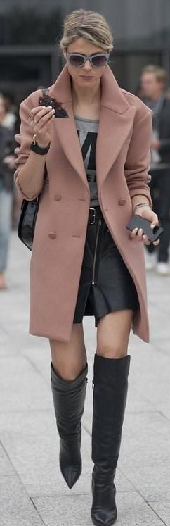 over the knee black leather boots with a pointed toe.... would love to have these