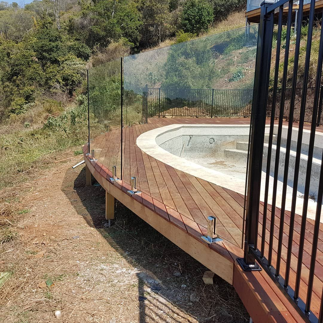 Curved Wooden Pool Deck With Glass Pool Fencing Decks Around Pools Wooden Pool Deck Timber Deck