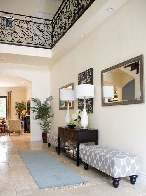 Entryway ideas. I love ottomans...they are so versatile in their ...