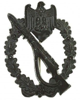 Silver Grade Infantry Assault Badge  A Silver Grade Infantry Badge - In zinc alloy, silvered, unmarked, 63,33 x 47,49 mm, vertical pinback.