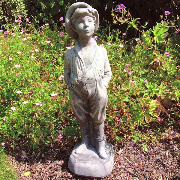 This Statue Depicts A Young Boy Whistling Wearing Cloth Cap And