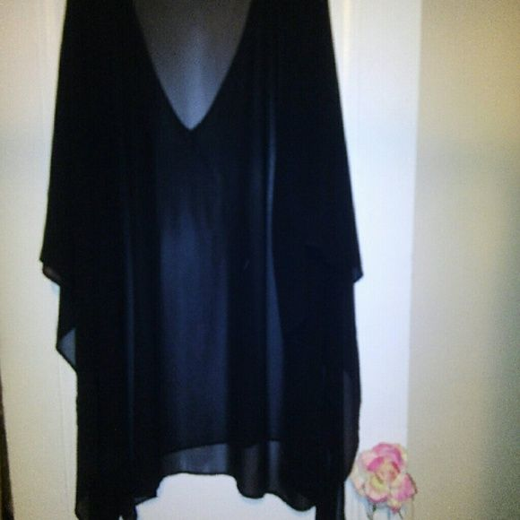 Woman Top This beautiful sheer top can be woman with your favorite leggings or jeans. Just add your favorite top underneath and be on your way Tops Tunics
