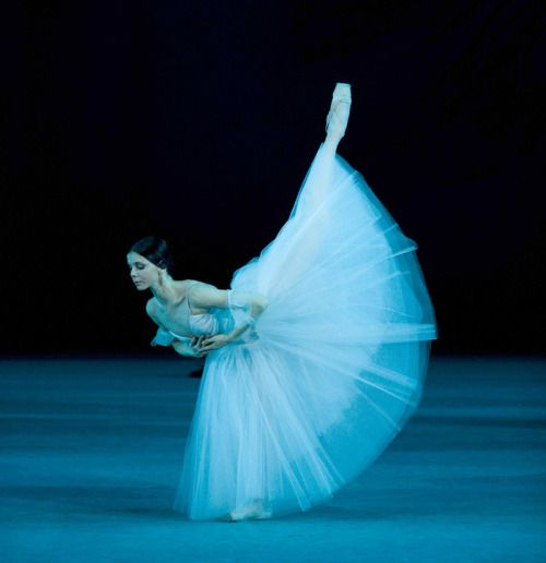 books0977:  Natalia Osipova in Giselle Act II, Mariinsky Ballet, photo by Damir Yusupov, 2010. Osipova's Giselle, particularly in the Act II Grand Pas de Deux, is so devoid of classical purity that one wonders if she has already dedicated herself to contemporary ballet, dancing one of the most fundamentally lyrical roles with fervent expression and considerably relaxed attention to form.