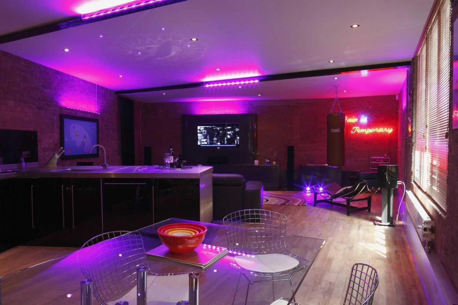 Open Plan Retro Living Room With Neon Lights Interiors Straight Out Of The Most Popular B Mood Lighting Bedroom Mood Lighting Living Room Neon Lights Bedroom #neon #light #living #room