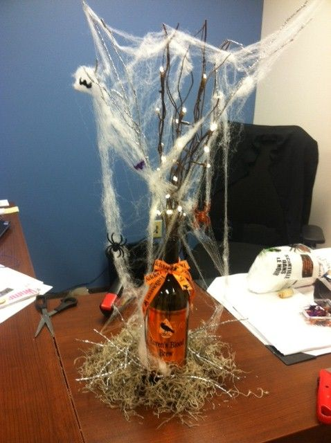 Fall/Halloween Centerpieces    Relabel Wine Bottles, Moss/Spider Web and lighted branches