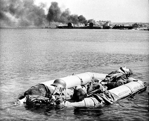 Ukrainian ssr soviet union an inflatable boat carries dead ukrainian ssr soviet union an inflatable boat carries dead german soldiers after the wehrmacht sciox Image collections