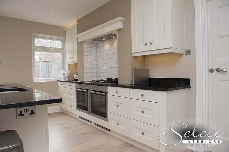 Black stone kitchen island and worktop by Landford Stone with Select Interiors.