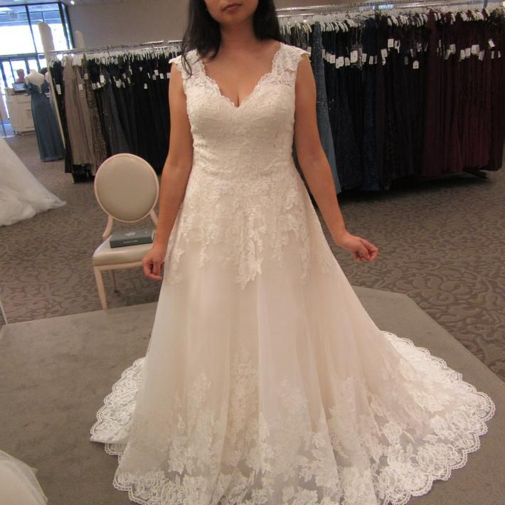 Princess dreams come true in a traditional ball gown wedding dress ...