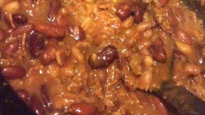Ground beef, bacon, and onions are cooked with baked beans and pinto beans in a zesty sauce. A great potluck dish!