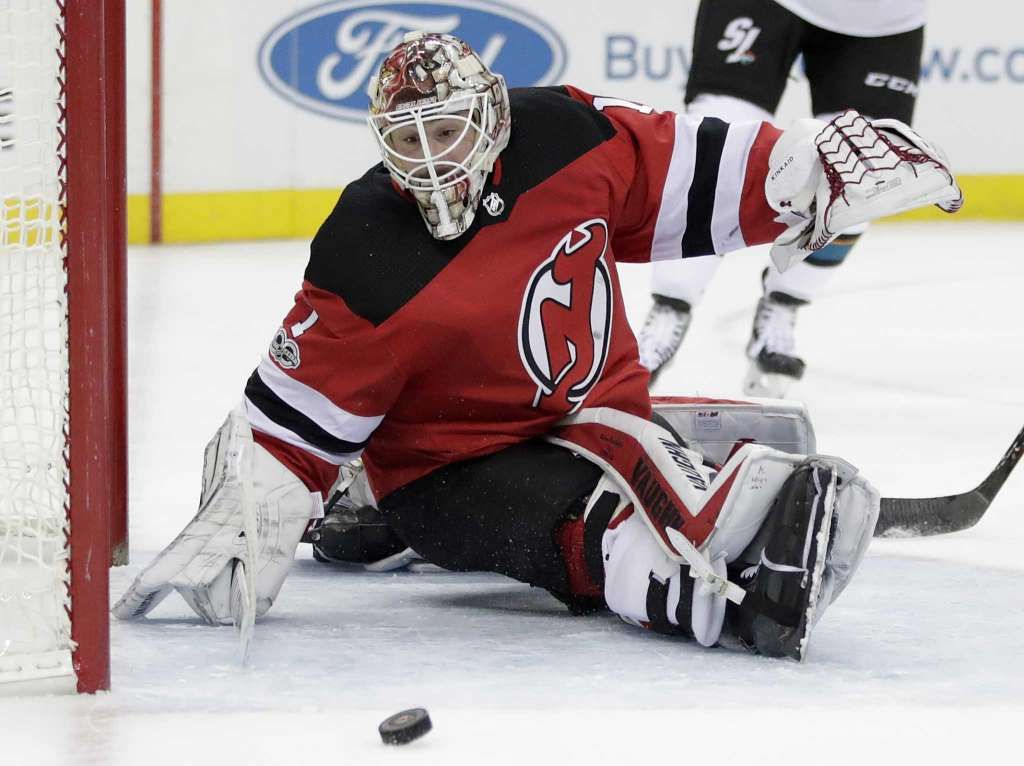 New Jersey Devils goalie Keith Kinkaid watches as a shot by