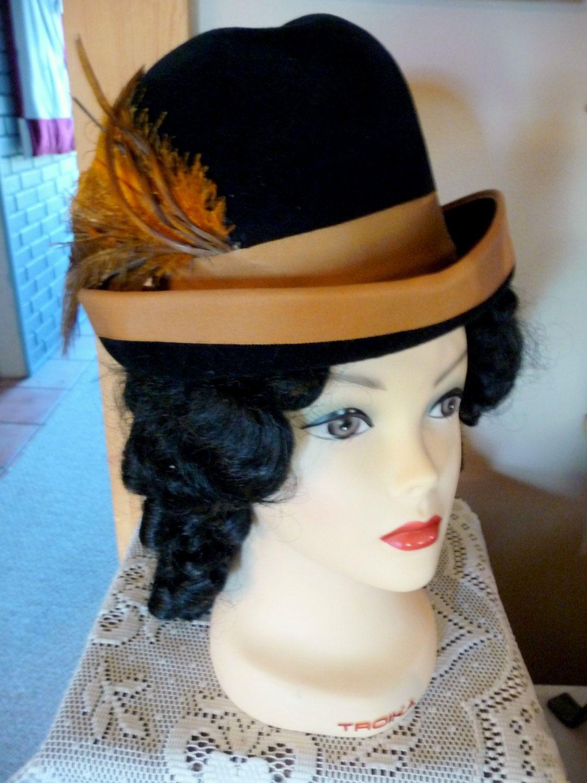 A tall black velvet ladies bowler hat by HatsByMaryAnn on Etsy