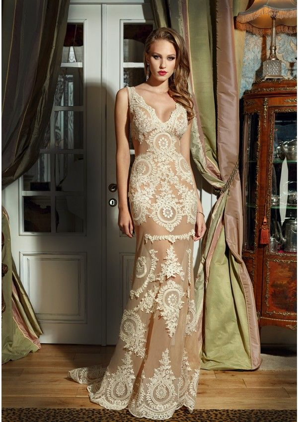 Nude tulle wedding gown with ivory lace applications Deep V ...