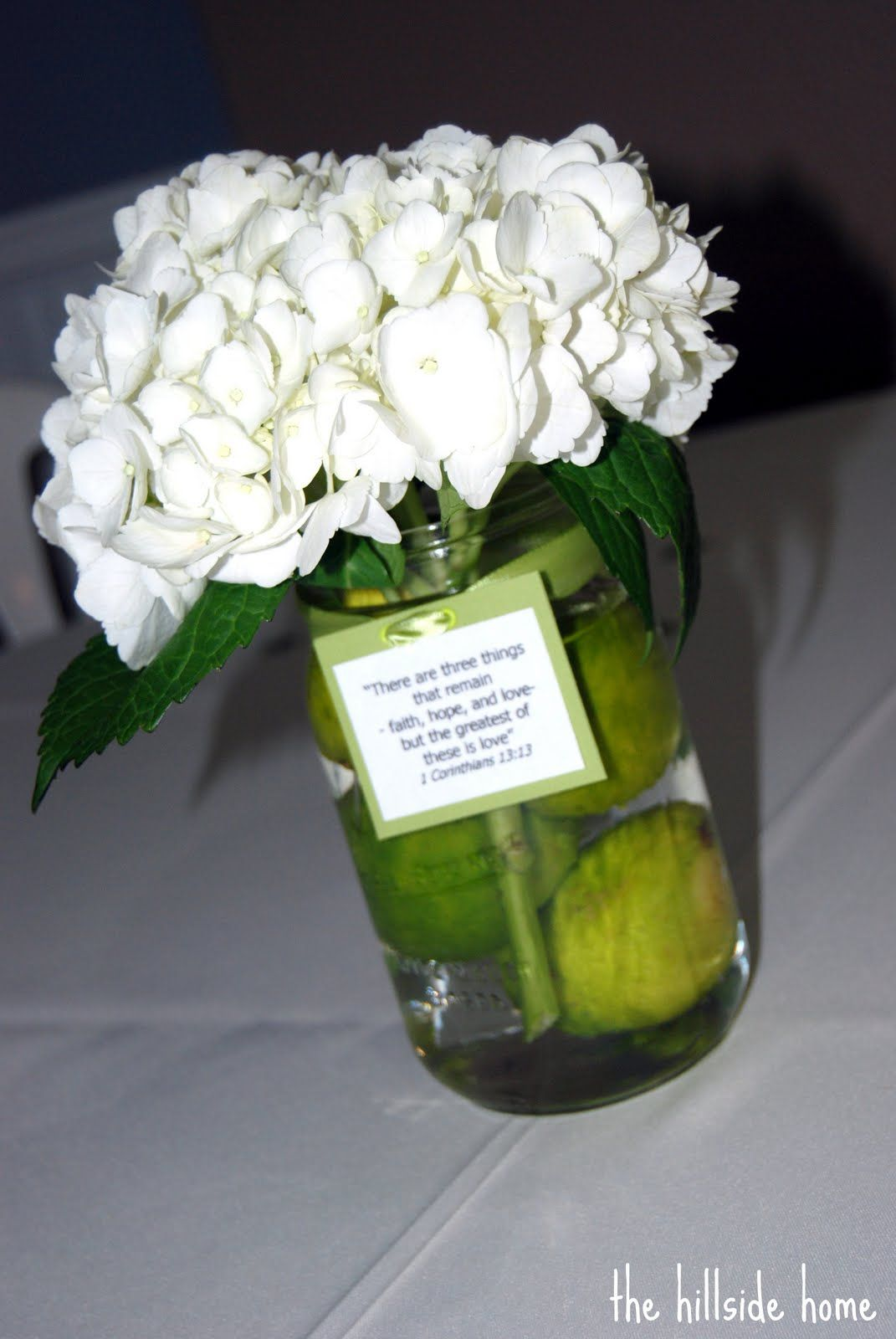 Mason jar centerpieces nice touch with adding the ribbon with a