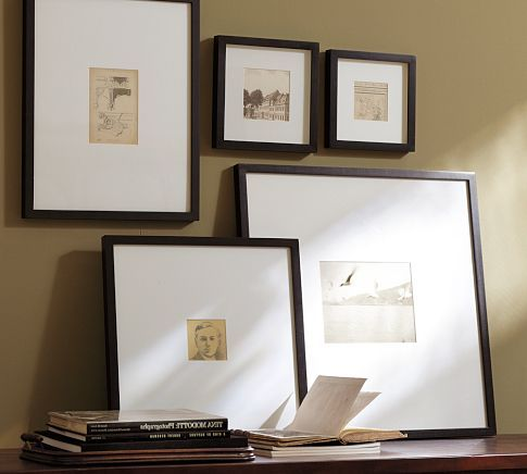 I love small pictures in extra large frames with big white matting
