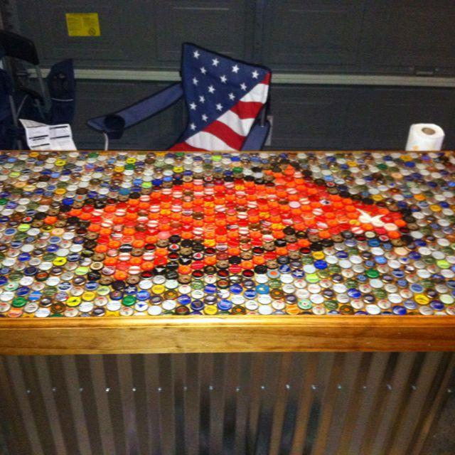 Bar top made out of beer bottle caps razorback pride for Beer cap bar top