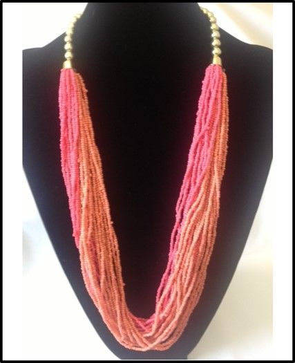 Two tone coral beaded necklace with gold, pearl sized accent $20    www.ShopBLVDBoutique.com
