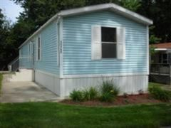 Light blue siding - 1990 Fleetwood Mobile / Manufactured Home in