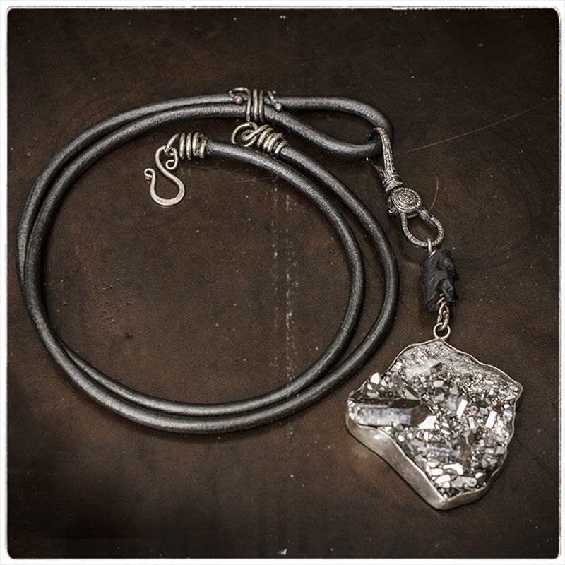 This amazing Crystalline Magic Necklace is now available!....Long strands of soft leather, a one of a kind sterling silver clasp, black snake vertebrae, our favorite infinity clasp which spins and opens on two sides, rough cut diamonds, dyed quartz and more! A true stunner!  http://www.shopthescarab.com/products/crystalline-magic-necklace