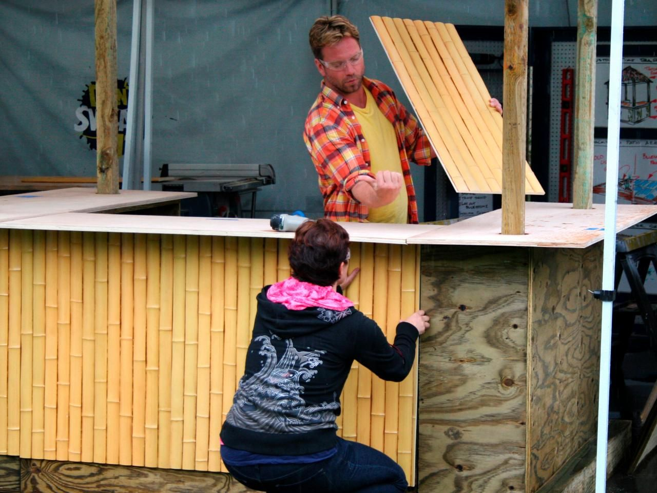 HGTV Takes Outdoor Entertaining To New Heights By Building A Three Sided  Tiki Bar With Bamboo Accents And A Grass Roof.