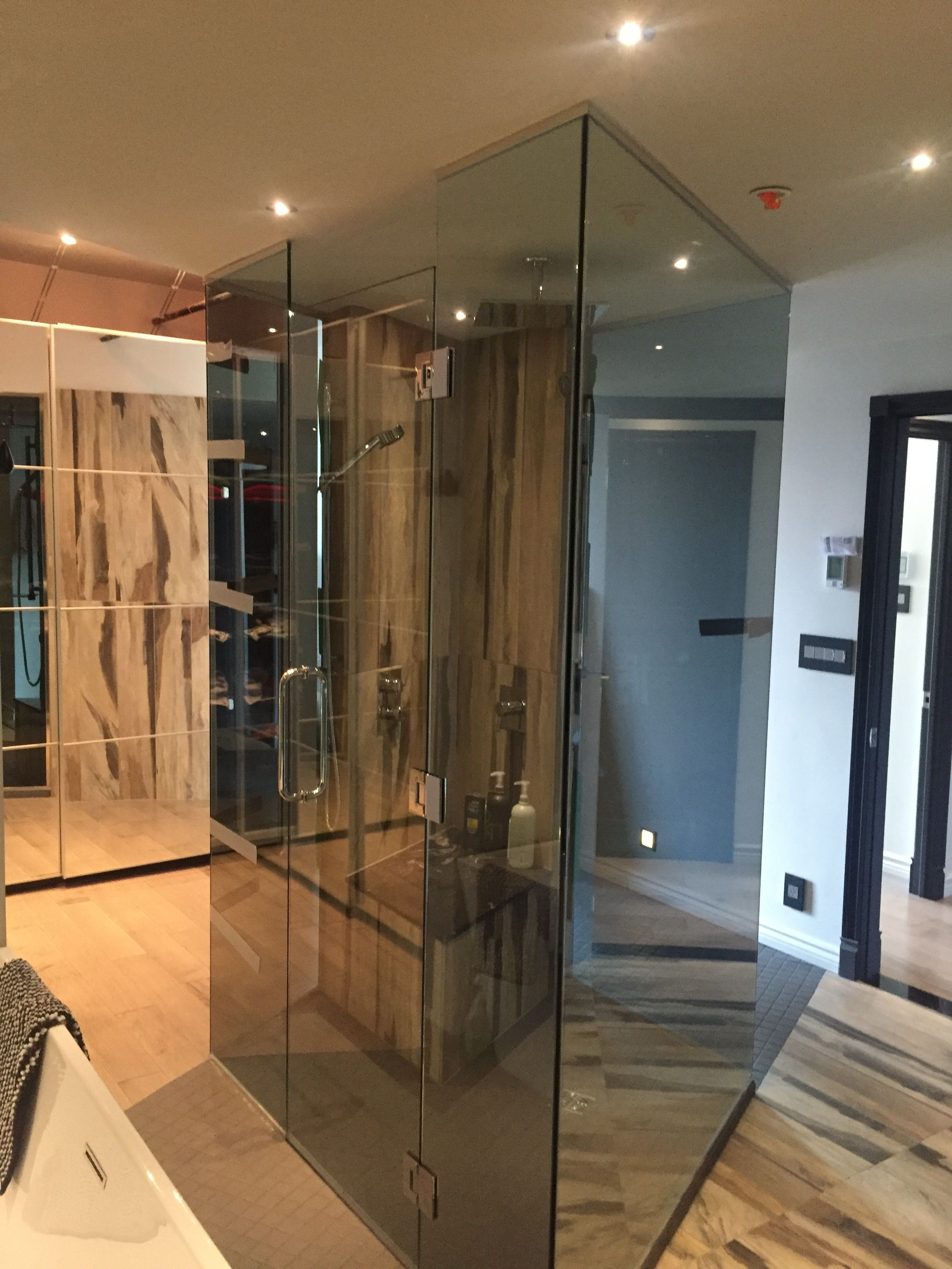 large custom walk in shower that stands as a centerpiece in the ...