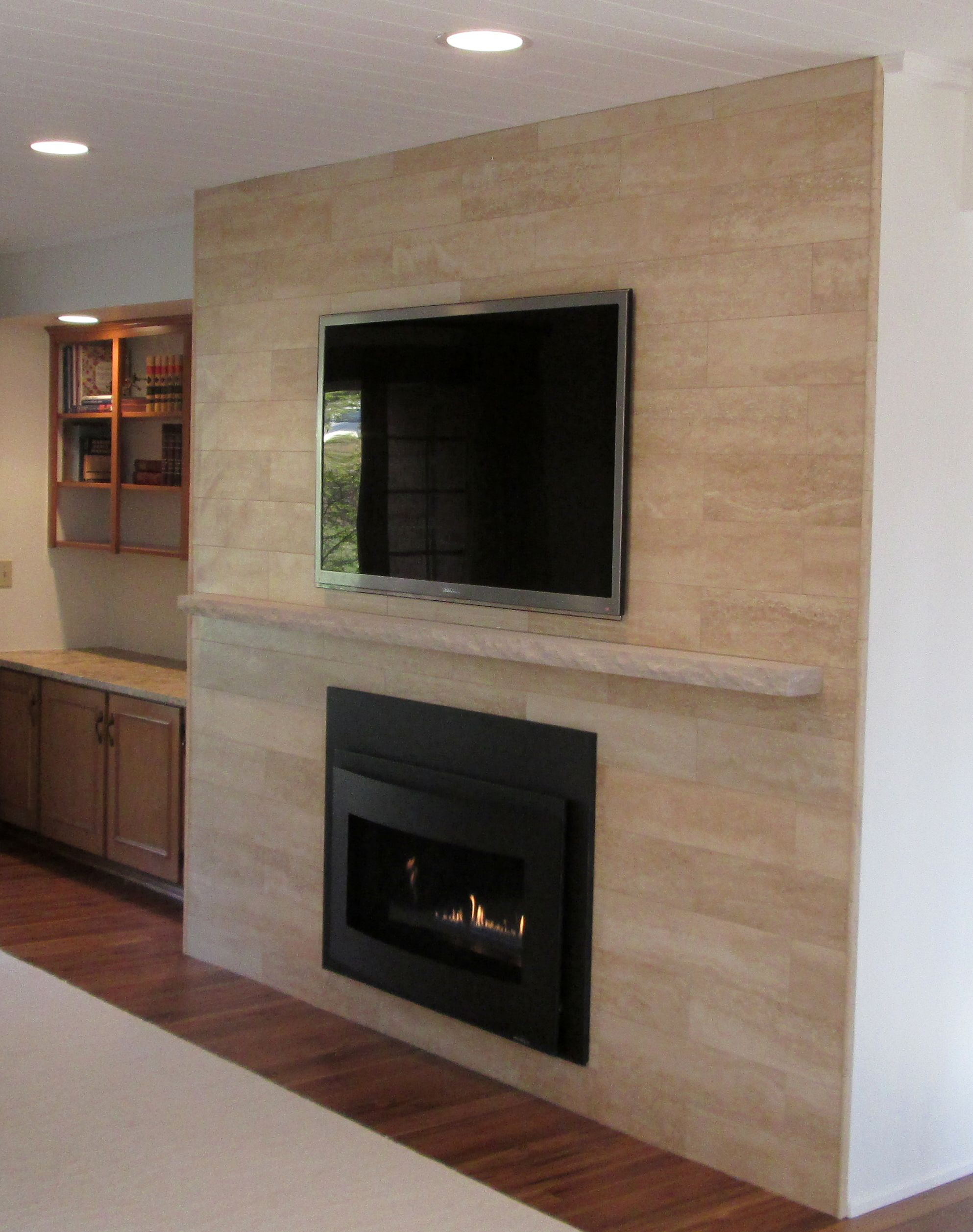 sant agostino 6 u201d x 24 u201d plank travertine tile in beige on fireplace