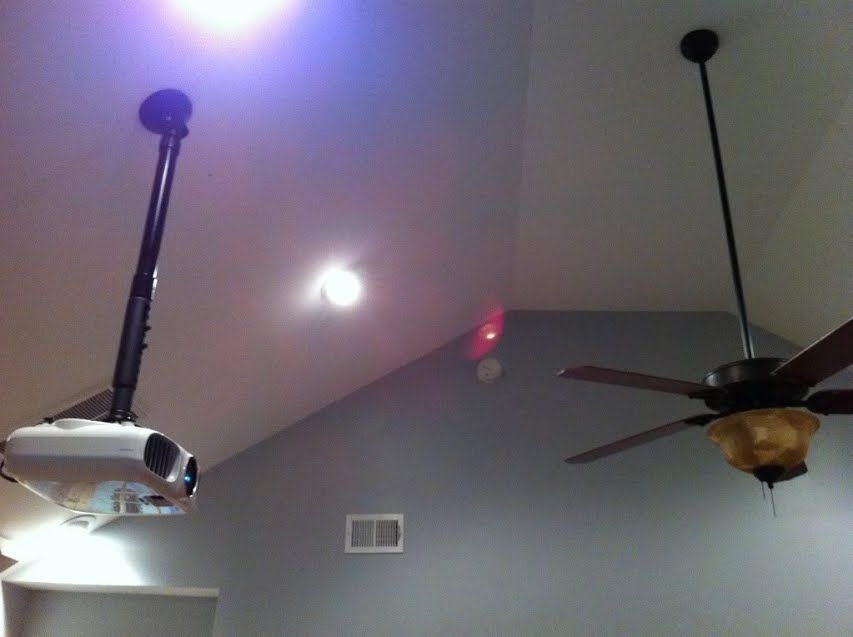 An Epson Projector Mounted To The Ceiling In Living Room Home