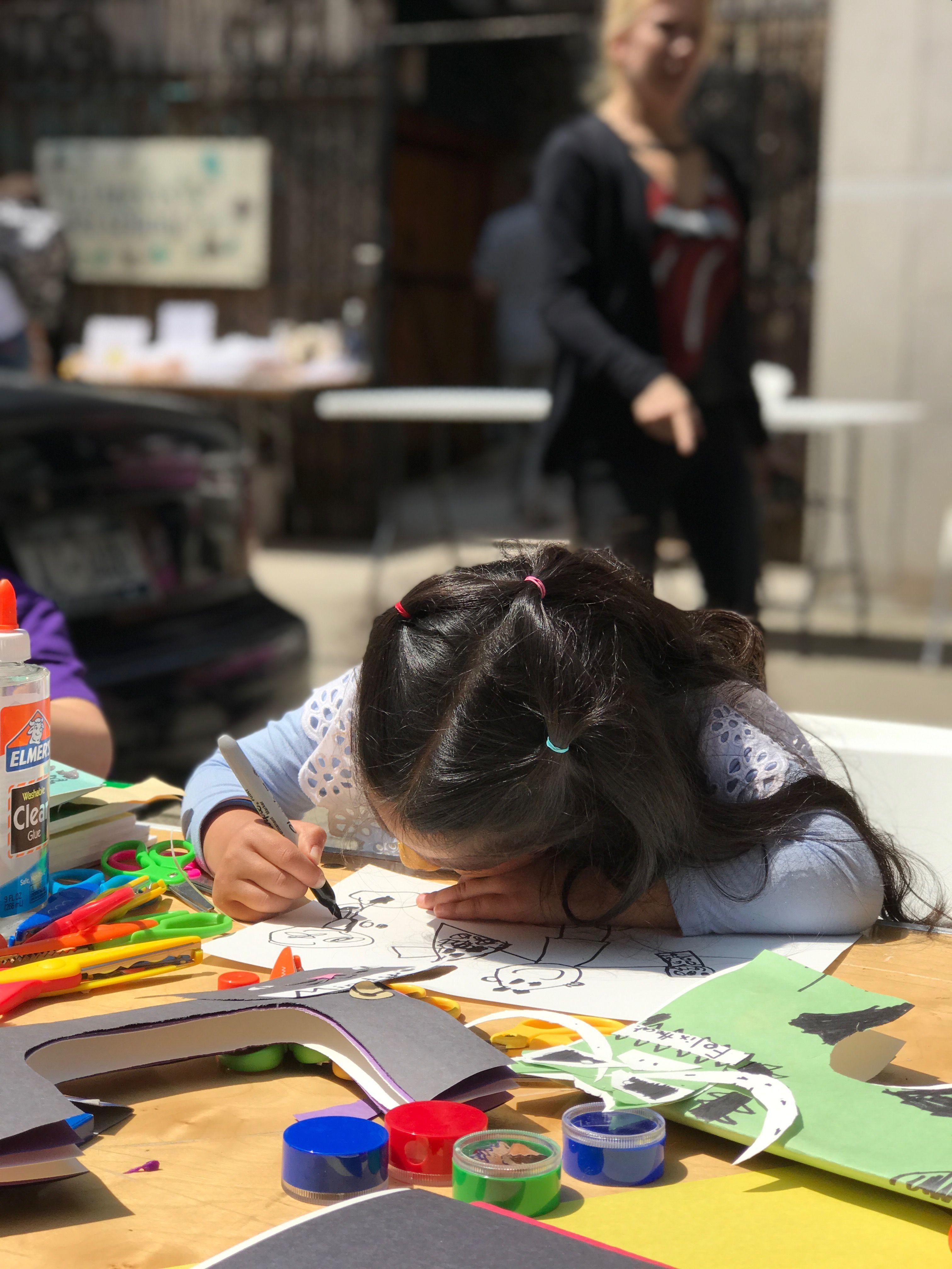 Kids making animal drawings with volunteer artists