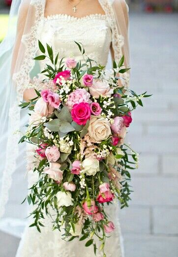 ultra romantic cascading wedding bouquet which includes pink peonies pastel blush garden roses