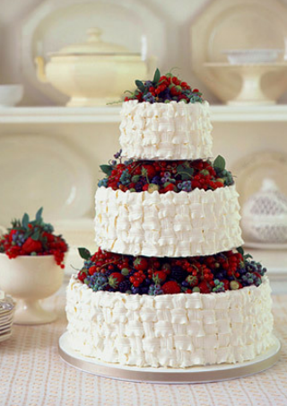 Reminds me of our wedding cake... 13 years ago!  We had sugared fruit at the very top- great for a summer wedding!