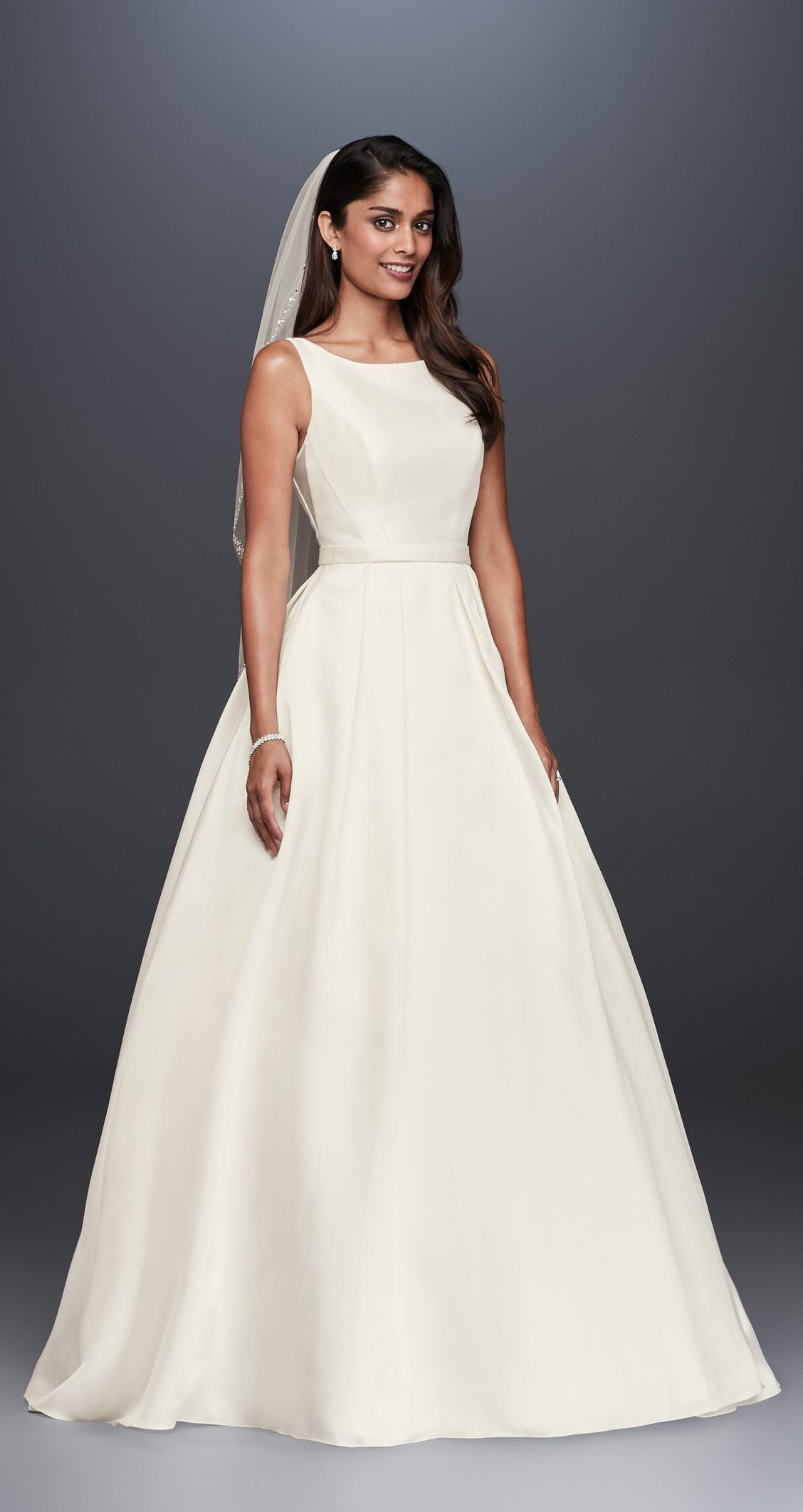 For a traditional wedding wear this highneck satin ball gown