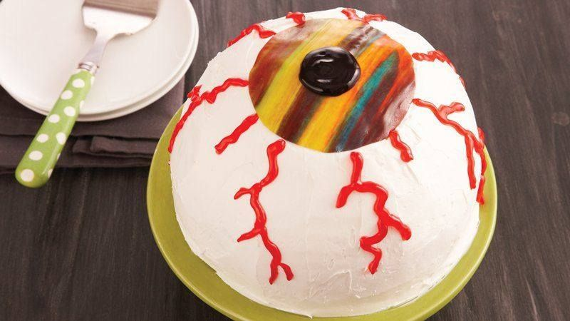 HALLOWEEN EYEBALL CAKE   Ingredients  1 box (16.25 oz) white cake mix  Water, vegetable oil and egg whites called for on cake mix box  1 container fluffy white whipped ready-to-spread frosting  1 roll chewy fruit snack, any flavor (from 5-oz box)  1 tube (0.68 oz) black decorating gel  1 tube (0.68 oz) red decorating gel  SE FULL RECIPE: https://www.facebook.com/photo.php?fbid=10153622717826667&set=o.1467074513581142&type=1&theater