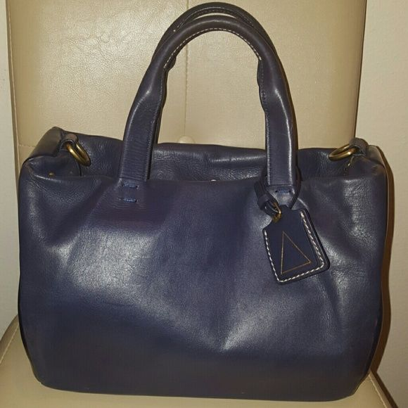 Navy Kelsi Dagger Brooklyn bag. Lightly worn but was disapointed because corners faded for an expensive purse. Comes with a shoulder strap. Plenty of pockets inside. Kelsi Dagger Bags