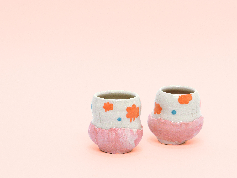 #porcelain #handmadeceramics #wheelthrown #studiopottery #coloredclay #cricutuses #illustratedpottery #budvase #ceramics #vases #airplantholder #marbledclay