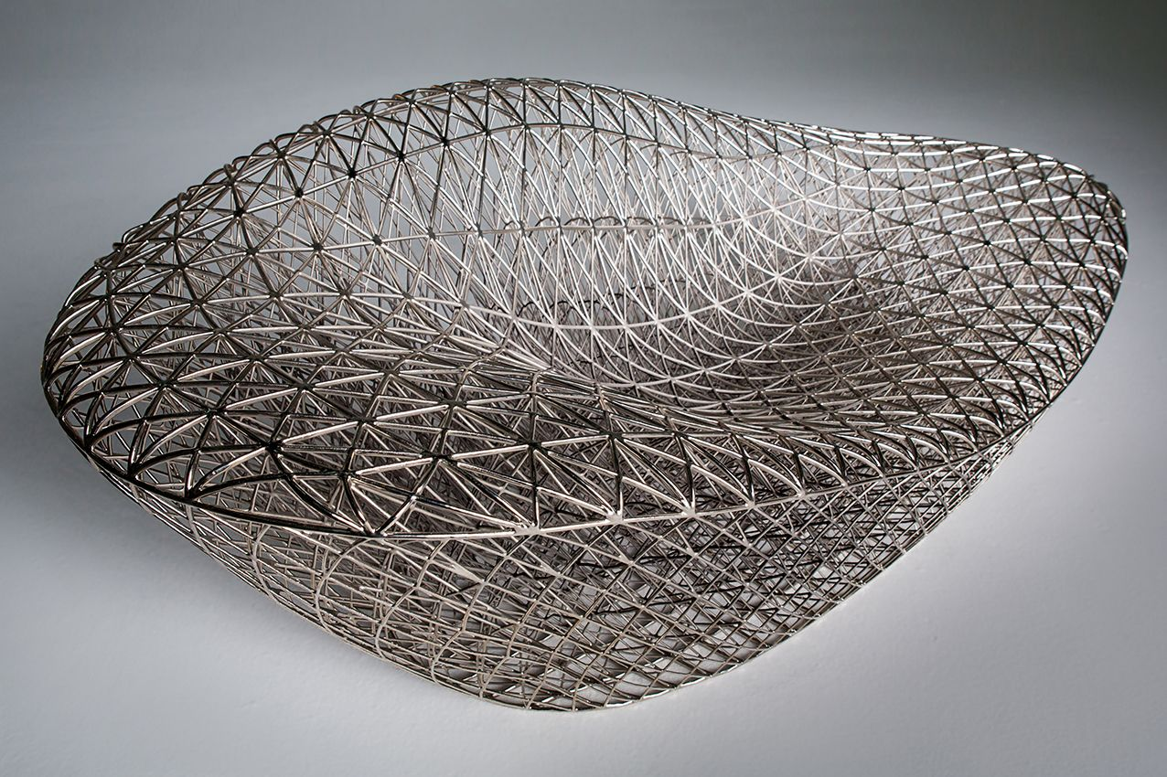 Dezeen This 3d Printed Sofa Is Made From A Mesh Inspired Printed Sofa Sofa Design 3d Printed Furniture