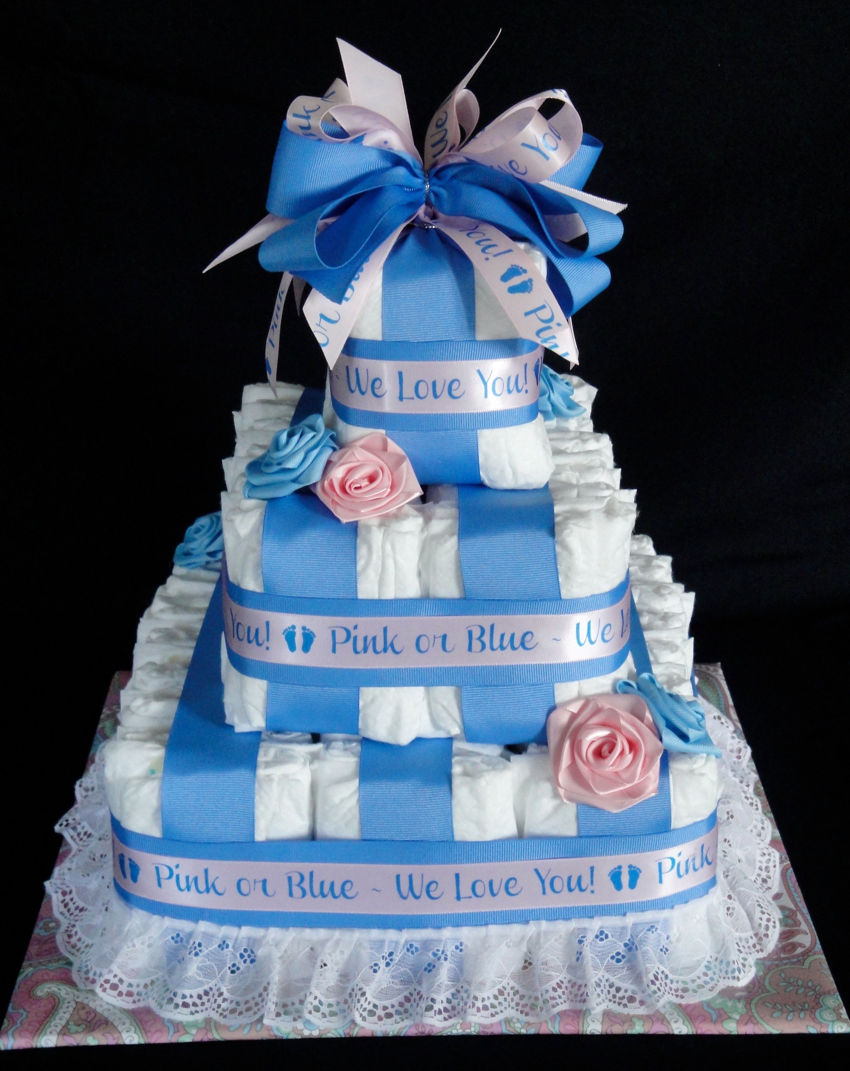 Diaper cake made for a gender reveal party. www.facebook.com/DiaperCakesbyDiana