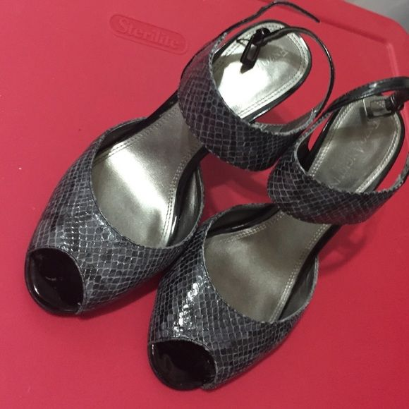 """Strapy Grey & Black Heels Gently used grey & black - snake print heels. It has some minor scratches around the heel area, but nothing major or really noticeable. price reflects scuffs. Heel is 4"""" high. True to size. Enzo Angiolini Shoes Heels"""