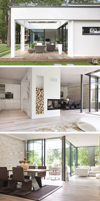 Fertighaus Bungalow Design modern mit Flachdach im Bauhausstil bauen Haus Ideen innen mit Kamin