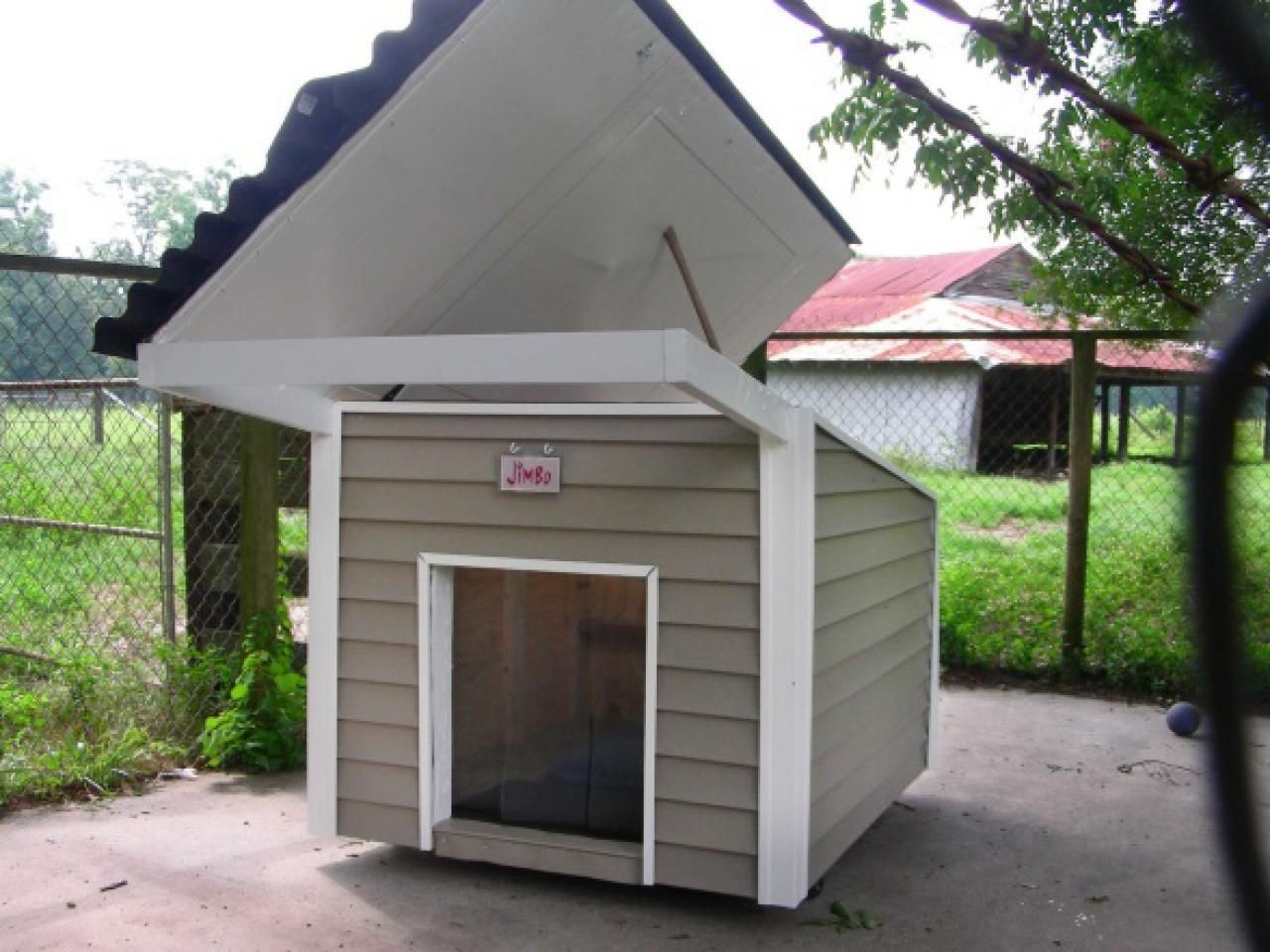 Hinged Roof Doghouse Build A Dog House Dog Houses Dog House Plans