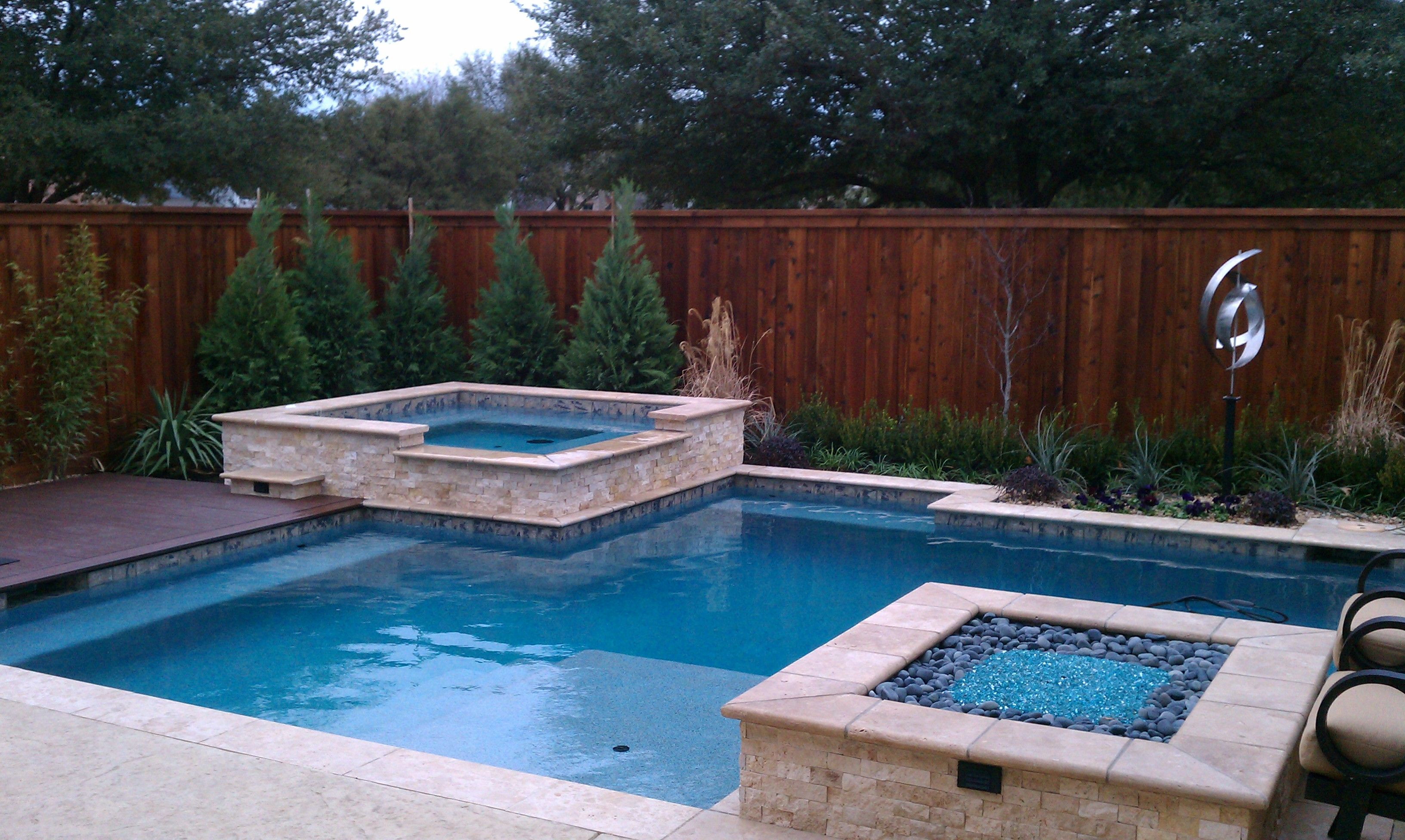 contemporary pool with nice strait lines. travertine coping