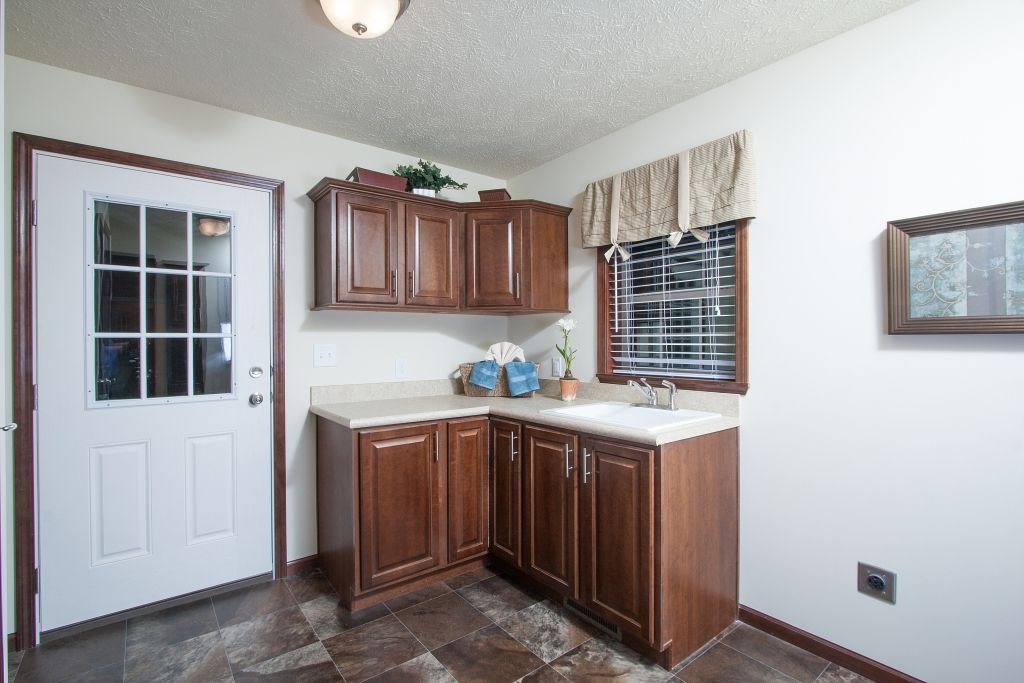 Bellevue AU208A   Aurora Classic Ranch Modular   Laundry Room With Utility  Sink And Built In Cabinets