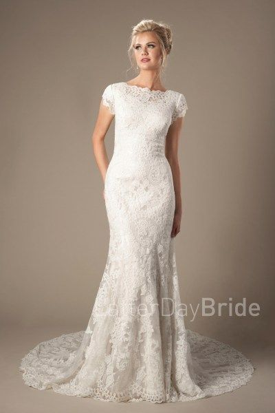 This Stunning Modest Lace Wedding Gown Features An Illusion Bateau Neckline And Delicate Scallops Adorning The Skirt