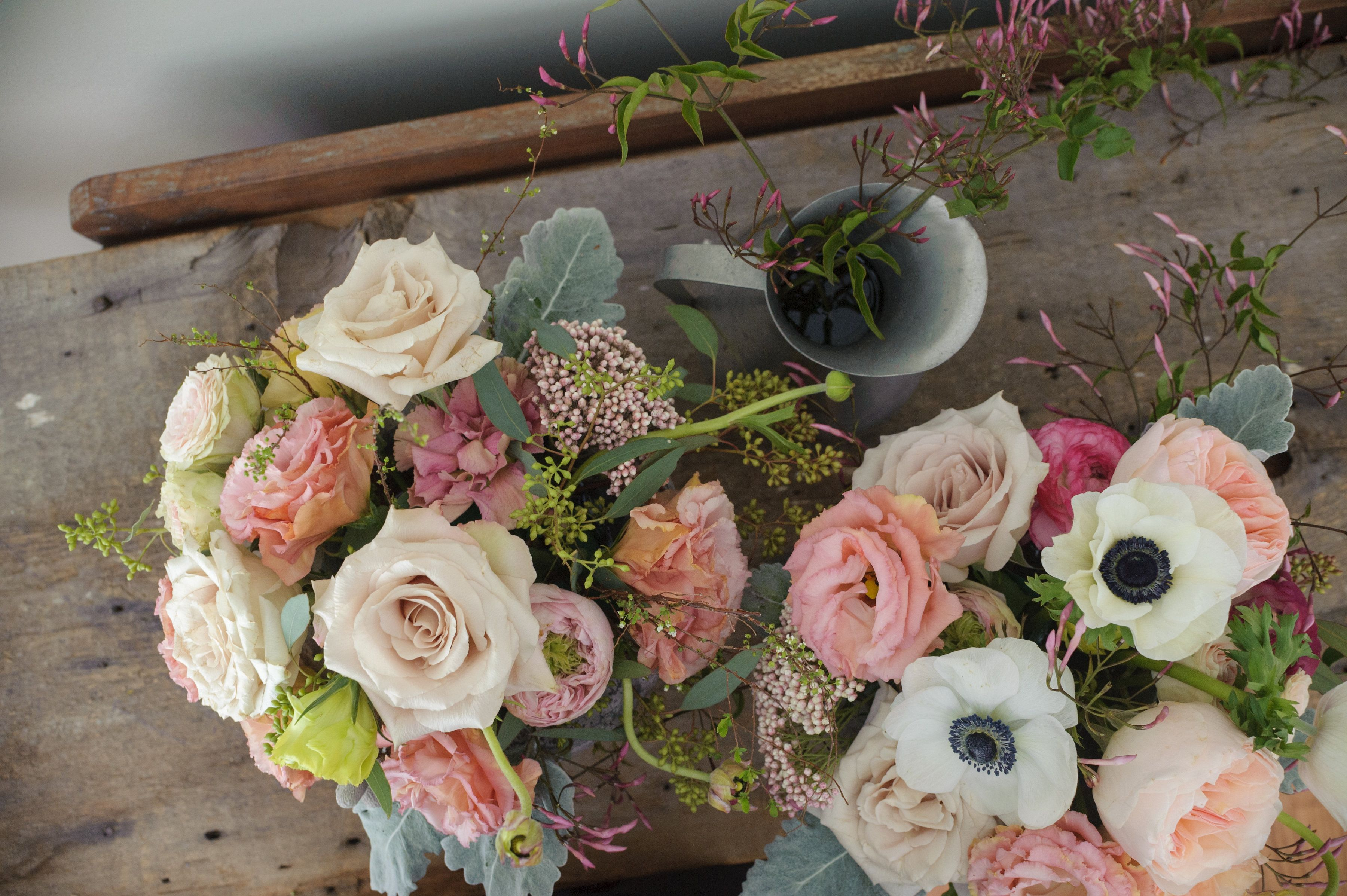 Romatnic Wedding Centerpieces In Blush Peach And White Made With Garden Roses Listhanthus Anemones Ros Wedding Flowers Wedding Florist Wedding Centerpieces